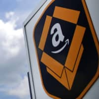 Amazon.com Inc.'s second-quarter revenue jumped after the online retail giant made investments to keep operating through the pandemic. | BLOOMBERG