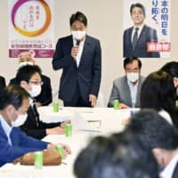 Former Defense Minister Itsunori Onodera (center) addresses a Liberal Democratic Party committee at a meeting to discuss defense policies held at the party's headquarters on Friday. | KYODO