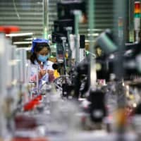 Data from China showed the country's manufacturing outlook improved for a second month in July. | AFP-JIJI