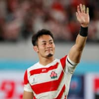 Brave Blossoms star Kenki Fukuoka waves to fans after Japan's defeat to South Africa in the 2019 Rugby World Cup quarterfinals on Oct. 20 at Tokyo Stadium. | REUTERS