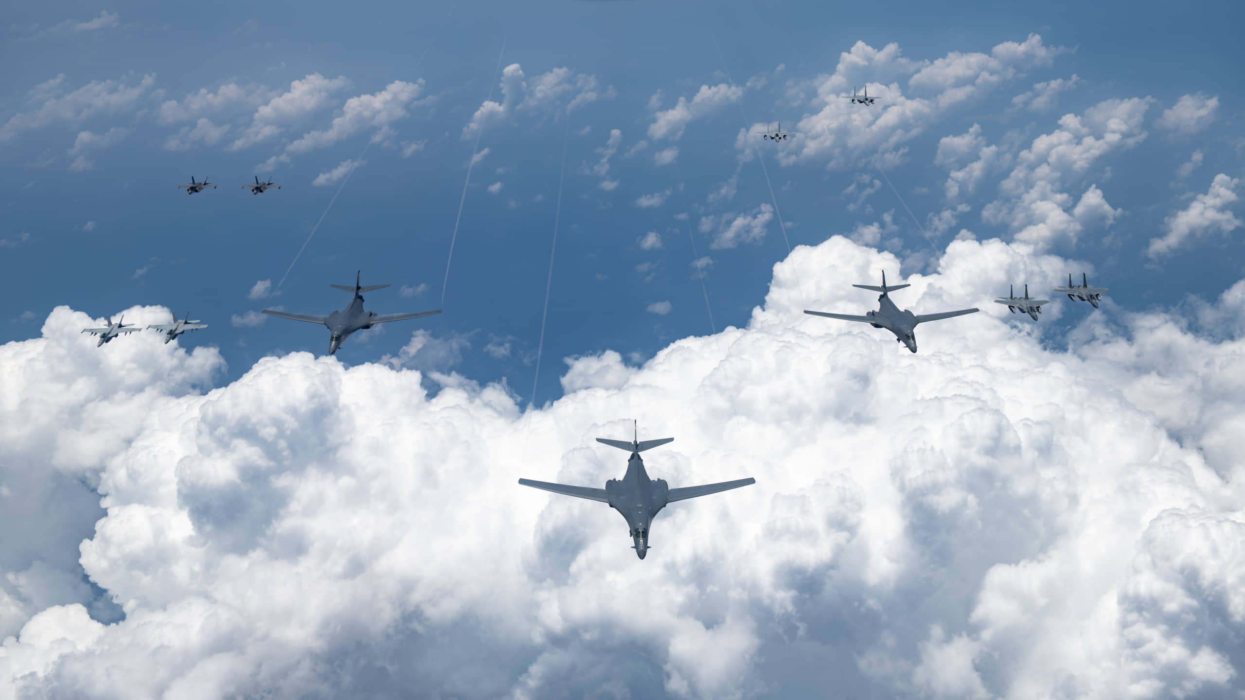 U.S. Air Force, Navy, Marine Corps and Air Self-Defense Force aircraft conduct a large-scale joint and bilateral integration training exercise on Tuesday in airspace near Japan. | U.S. AIR FORCE