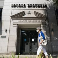 Brooks Brothers Group Inc. filed for bankruptcy in July, felled by the coronavirus pandemic's impact on clothing sales and its own heavy debt load. | BLOOMBERG