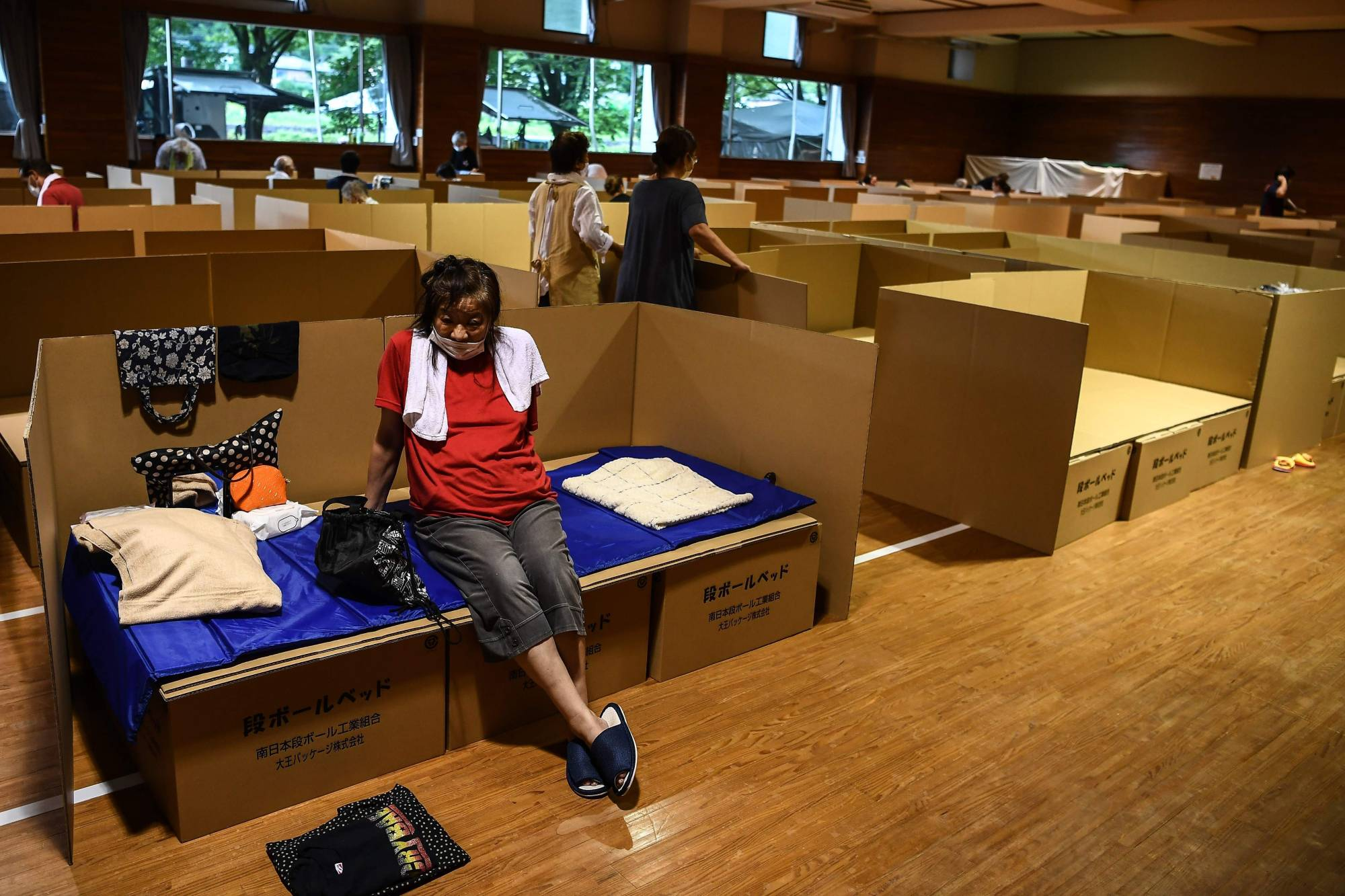 As well as simple partitions, companies have been making cardboard beds for evacuation shelters in Japan. | AFP-JIJI