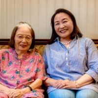 Mariko Higashino (right) is passing on the A-bomb testimony of her mother, Chisako Takeoka, as part of the Peace Memorial Museum's Legacy Successor program. | PETER CHORDAS