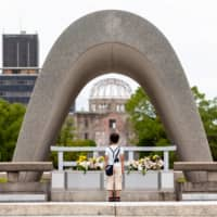 The cenotaph in Hiroshima's Peace Memorial Park is inscribed with the phrase, 'Let all the souls here rest in peace, for we shall not repeat the evil.' | PETER CHORDAS