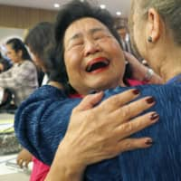 Happier times: Setsuko Thurlow, a Hiroshima atomic bomb survivor, celebrates at the United Nations after a treaty banning nuclear weapons was adopted.  | KYODO