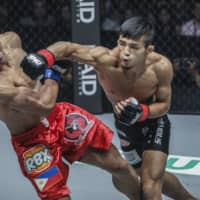 Yuya Wakamatsu lands a punch on Danny Kingad in their bout in September 2018 in Jakarta. | ONE CHAMPIONSHIP