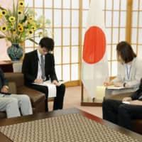 Then-Foreign Minister Taro Kono (left) holds a meeting with South Korean Ambassador to Japan Nam Gwan-pyo at the Foreign Ministry in Tokyo on July 19, 2019, to protest Seoul's refusal to establish an arbitration panel to resolve a dispute over wartime labor. | KYODO