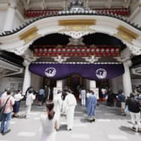 People line up to see a kabuki performance at the Kabukiza Theatre in Tokyo's Ginza district on Saturday. | KYODO