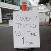 A drive-thru COVID-19 testing site at the Melbourne Sports and Aquatic Centre  | BLOOMBERG