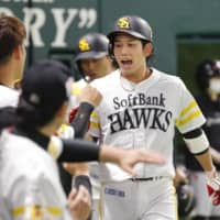Softbank's Ryoya Kurihara returns to the dugout after hitting a three-run home run in the first inning against the Lions in Fukuoka on Saturday. | KYODO