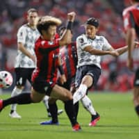 Vissel's Hotaru Yamaguchi (second from right) takes a shot on the Consadole goal in Sapporo on Sunday. | KYODO