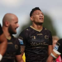 The Dragons' Israel Folau stands on the pitch during his team's match against St. Helens on Sunday in Leeds, England. | REUTERS