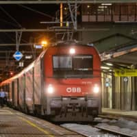 A night train run by Austria's Osterreichische Bundesbahnen railway stands at a platform at the station in Gries am Brenner at the Austrian-Italian border on Feb. 23. | APA / VIA AFP-JIJI
