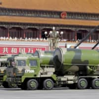 Military vehicles carrying Chinese DF-31A long-range missiles drive past Tiananmen Gate in Beijing during a military parade to mark the 70th anniversary of the end of World War II in September 2015. | REUTERS