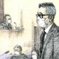 A court illustration shows Noriyuki Makihara listening to the ruling handed down at his trial in the Tokyo District Court on Monday. | KYODO