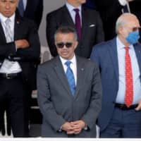 World Health Organization chief Tedros Adhanom Ghebreyesus attends the Bastille Day military parade honoring French health workers in Paris in July.  | REUTERS