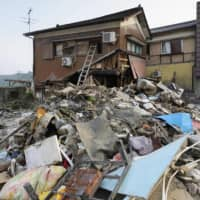 A home destroyed by floodwaters in the city of Hitoyoshi, Kumamoto Prefecture | KYODO