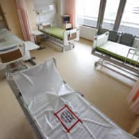 Beds reserved for coronavirus patients at a hospital in the city of Osaka | KYODO