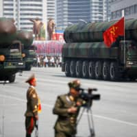 Intercontinental ballistic missiles are displayed during a military parade in Pyongyang in 2017. | REUTERS