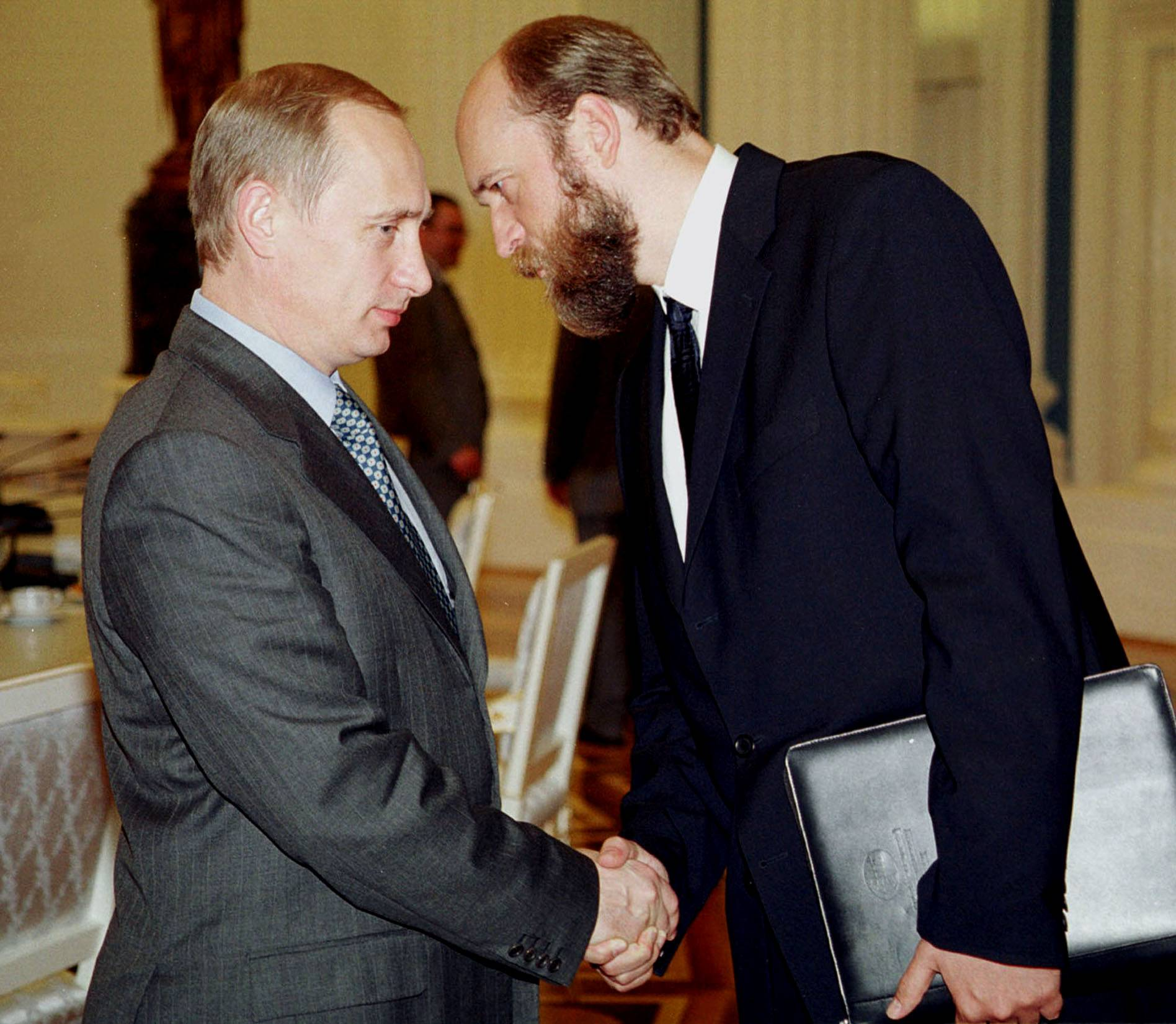 Russian President Vladimir Putin and Sergei Pugachev in July 2000. | TASS NEWS AGENCY / VIA REUTERS