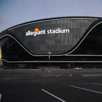 Lights adorn Allegiant Stadium, the new home of the Las Vegas Raiders football team, as it nears completion on July 22. | AP