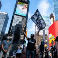 Protester supporting Hong Kong's pro-democracy movement attend the Delay No More, Democracy march at Times Square in New York City on Sunday. | REUTERS
