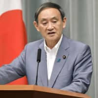 Chief Cabinet Secretary Yoshihide Suga speaks at a news conference in Tokyo on Tuesday. | KYODO