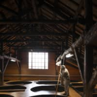 Sauce storage: Rows of 150-year-old vats fill the Oshingura storehouse. Each vat can hold 9,000 liters. | SHOGO OIZUMI