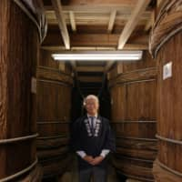 Carrying on a legacy: Kazuhiro Shibanuma is the 17th-generation head of Shibanuma Soy Sauce. 'When I was a boy, there were still artisans making these vats, but they are all gone,' he laments. | SHOGO OIZUMI