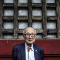 Terumi Tanaka, who survived the Nagasaki atomic bombing in 1945 at age 13, says he worries that interest in hibakusha is fading. | AFP-JIJI