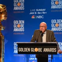 Hollywood Foreign Press Association president Lorenzo Soria tests the microphone ahead of the 77th Annual Golden Globe Awards nominations announcement at the Beverly Hilton hotel in Beverly Hills on Dec. 9. | AFP-JIJI