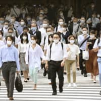 Medical associations had called for people feeling unwell to stay home for at least seven days after developing cold-like symptoms.   KYODO