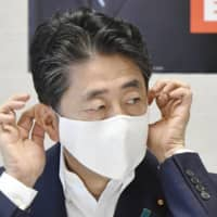Prime Minister Shinzo Abe attends a meeting with Liberal Democratic Party executives in Tokyo on Tuesday.   | KYODO
