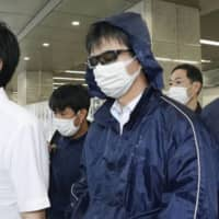 Alleged actions: Naoki Yamamoto arrives in Kyoto after being arrested on suspicion of assisting a death. | KYODO