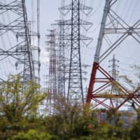Japan's industry ministry reviewing power line rules to bolster renewable energy