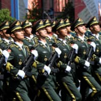 China's People's Liberation Army soldiers march during the Victory Day Parade in Red Square in Moscow on June 24.  | SERGEY PYATAKOV / VIA REUTERS