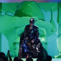 Lil Nas X performs 'Old Town Road,' a song that was a product of virtual work, at the 62nd Grammy Awards in Los Angeles on Jan. 26. | REUTERS