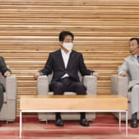 Prime Minister Abe attends the cabinet meeting Tuesday. | KYODO