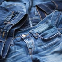 Feeling blue: Young people's tastes in clothes have diversified and jeans are no longer seen as the fashion standard. | GETTY IMAGES