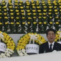 Prime Minister Shinzo Abe delivers a speech during a ceremony to mark the 75th anniversary of the bombing at the Hiroshima Peace Memorial Park on Thursday. | AP