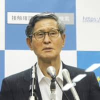 Shigeru Omi, head of a government panel on the coronavirus, speaks at a news conference on Wednesday. | KYODO