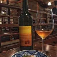 Lasting impressions: A glass of orange wine from Maria and Sepp Muster served at a restaurant in Tokyo's Nishiazabu neighborhood. | MELINDA JOE