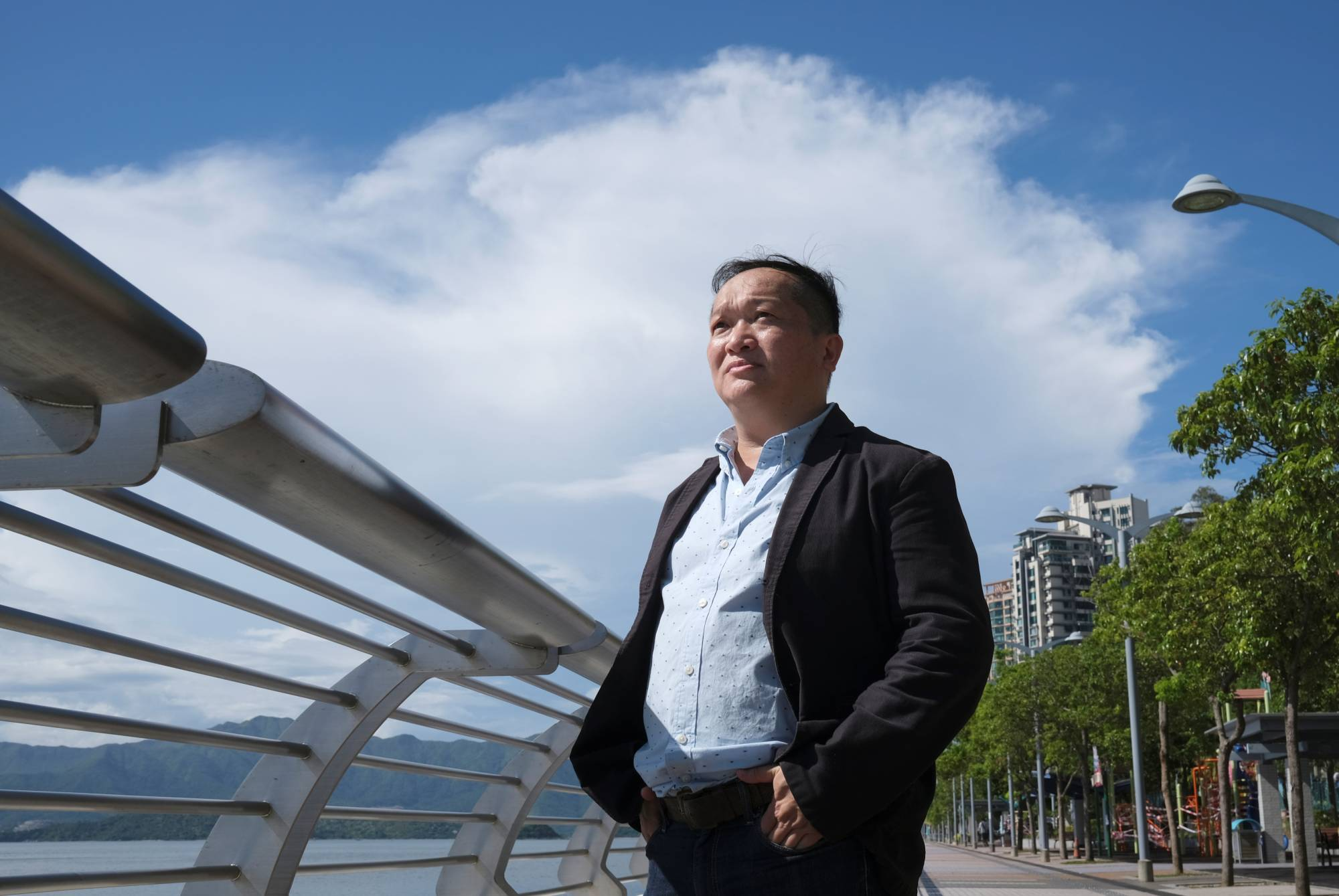 Ricky Wong Wai-hung, 54, pastor-in-charge of Trinity Theological Baptist Church, said the 120 or so members of his church — which include many members of the uniformed services plus some doctors and teachers — pray at secret locations for fear of being targeted by pro-democracy activists. | REUTERS