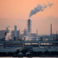 Factories are seen near Tokyo. The coronavirus pandemic may have caused structural changes in Japan's economy, requiring the Bank of Japan to tap more deeply into big data in making policy decisions. | REUTERS