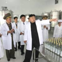 North Korean leader Kim Jong Un gives guidance at the Ryongmun Liquor Factory in this undated photo released by North Korea's Korean Central News Agency in Pyongyang in May 2014. | KCNA / VIA REUTERS