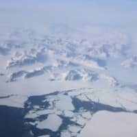 Broken up sea ice is seen from the window of a NASA Gulfstream III flight as part of a research mission above the east coast of Greenland March 2018. | REUTERS