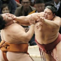 Abi (right) attacks Mitakeumi during the 2019 Kyushu Basho in Fukuoka. The former komusubi was handed a three-tournament suspension on Thursday after violating the Japan Sumo Association's anti-coronavirus guidelines during last month's July Grand Sumo Tournament in Tokyo. | KYODO