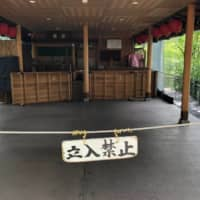 A notice and cordon prohibit entry to a closed tea house inside Kiyomizu Temple in Kyoto on July 21, as the novel coronavirus continues to spread. | REUTERS