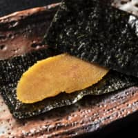Layers of flavor: Mellow-flavored and springy in texture, karasumi dried mullet roe is served between crisp sheets of nori.